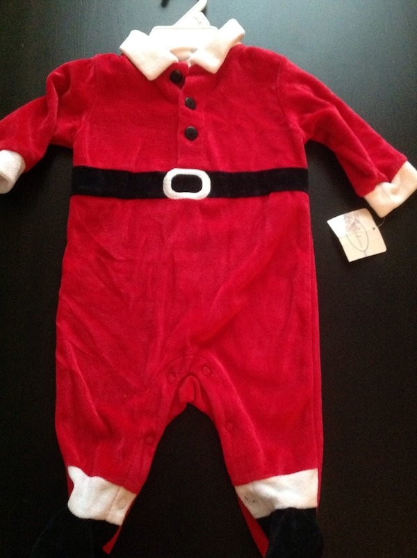 Brand new comes with Santa hat size 0-3 months