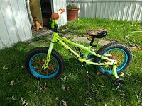Green Mongoose bicycle with training wheels