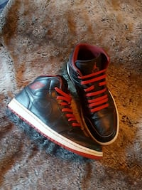 pair of black-and-red Nike basketball shoes Calgary, T2H 3B5
