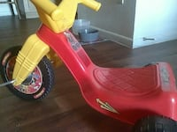 toddler's red and yellow plastic trike