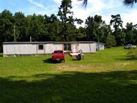 Mobile home 20 acres of land with own pond Millen