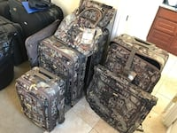 five green-and-gray camouflage luggage bag set