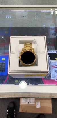 gold and black digital watch