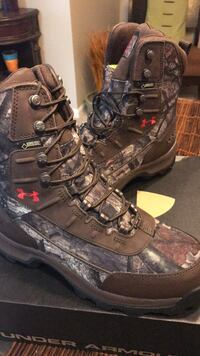 Pair of black-and-brown hiking boots 8 mi