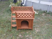 Small dog house made out of cedar