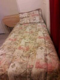 white and pink floral bed sheet