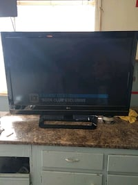 black flat screen TV with remote Calgary, T2B 3C4