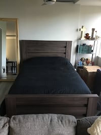 Brown wooden bed frame with gray bed sheet Arlington, 22202