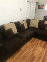 Dark brown fabric sectional sofa with throw pillows New York, 10312