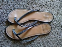 black-and-brown leather flip-flops