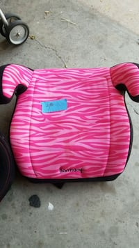 pink and white Harmony booster seat Odessa
