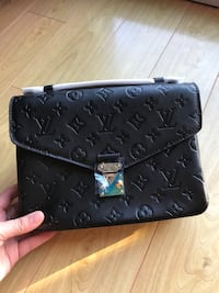 black monogrammed Louis Vuitton leather wristlet Toronto, M1T 3P4