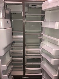 KITCHEN AID SIDE BY SIDE STAINLESS STEEL REFRIGERATOR! Read below
