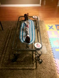 GLASS COFFEE TABLE WITH METAL FOOTH AND COME WITH  ONE SIDE  TOO