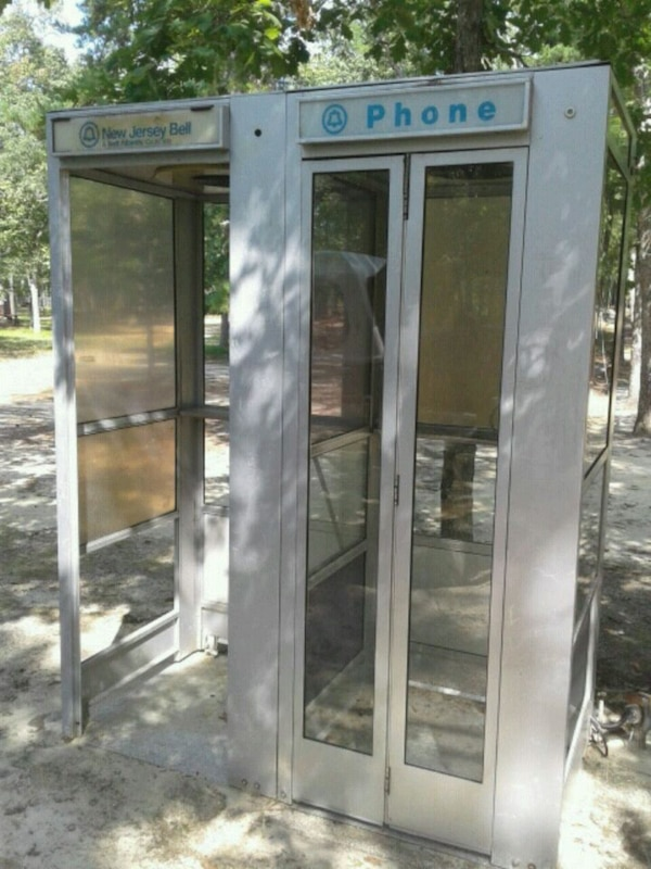 Double phone booth one is missing phone