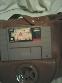 gray SNES game cartridge with brown leather Michael Kors shoulder bag Los Angeles, 90042