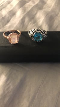 One ring gold with opal the other silver with aqua marine
