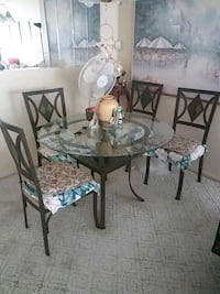 round glass top table with four chairs dining set Clearwater, 33763