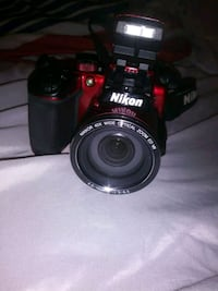 black Nikon DSLR camera with lens Davenport, 33837