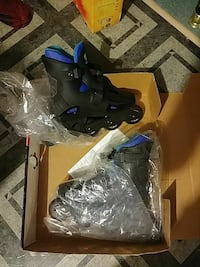 pair of black and blue inline skates
