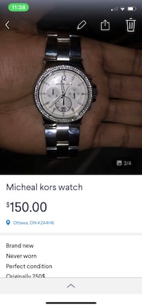 round silver chronograph watch with silver link bracelet screenshot Ottawa