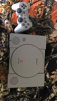 white Sony PS1 console with controller
