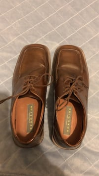 Pair of brown kenneth cole reaction leather dress shoes