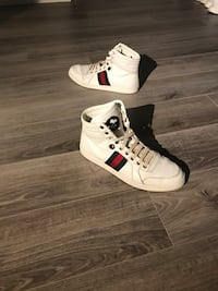 pair of white-and-red Gucci high-top sneakers