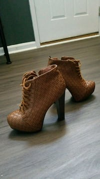 pair of brown leather heeled booties 13 km