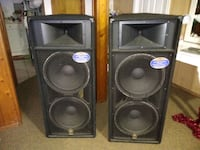 two black-and-gray PA speakers