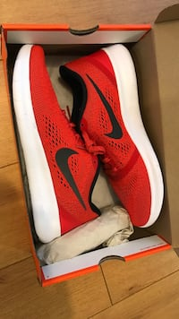 Pair of red nike low-top sneakers with box Montréal, H3N 2S1