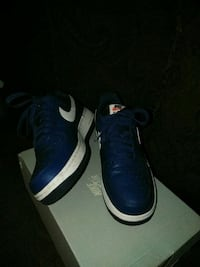 pair of blue-and-white Nike basketball shoes Jacksonville