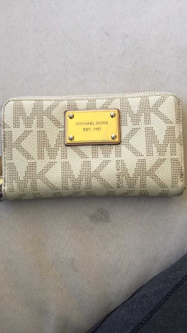 White and gray michael kors leather wallet