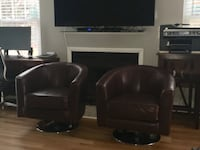 Two brown 100% real leather swivel chairs with chrome bottoms Virginia Beach, 23452
