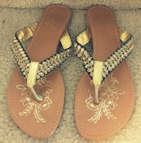 pair of brown-and-black leather sandals Ashburn, 20148