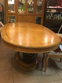Oval brown pedestal table (includes 6 chairs) Thousand Palms