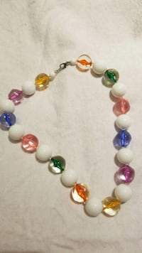 white, pink, and green beaded bracelet