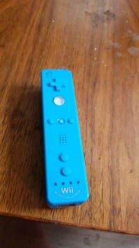 blue and white Nintendo Wii game controller Two Rivers, 54241