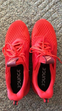 Pair of red-and-black running shoes