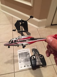 Gray and red r/c toy helicopter