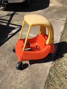 orange and yellow Little Tikes cozy coupe
