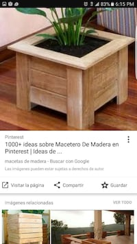 brown wooden table with green plant