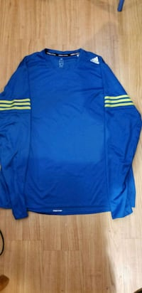 blue and white Adidas track pants Calgary, T2B 2C7