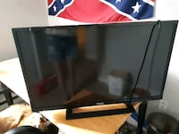 black flat screen TV with remote Brantford, N3T 5Z1