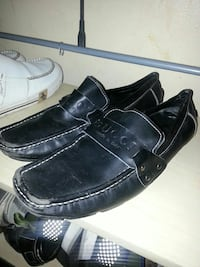 pair of black Gucci leather square-toe loafers