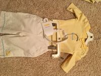 yellow short-sleeved shirt and white pants