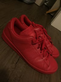 Pair of red nike low-top sneakers Calgary, T3N