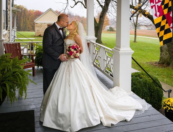 Size 8, cathedral length satin edge veil and removable halter strap included.