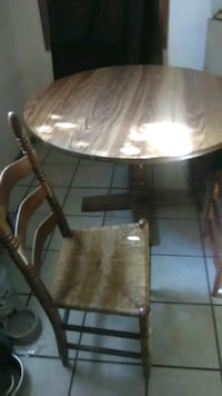 round brown wooden table with chairs Kingman, 86409
