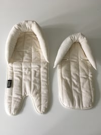 baby's white and gray sleeping bag